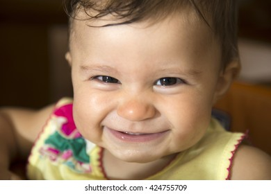 Close-up of smiling little one year old baby girl