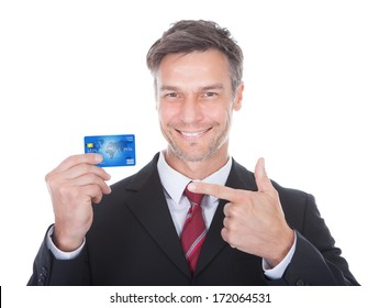 Close-up Of A Smiling Mature Businessman Holding Credit Card