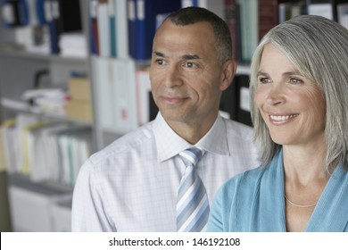 Closeup of a smiling middle aged business couple in office