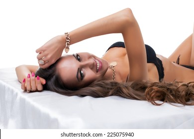 Close-up of smiling pretty model lying in studio