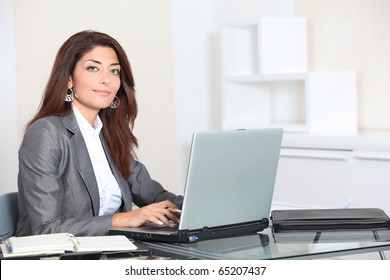 Closeup of smiling real estate agent in office