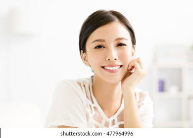 closeup smiling young asian woman face