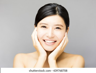 closeup  smiling young  woman face with clean  skin
