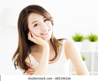 closeup smiling young  woman face