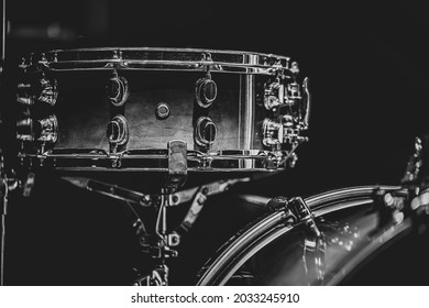 Close-up of a snare drum, percussion instrument on a dark background with haze, beautiful lighting.