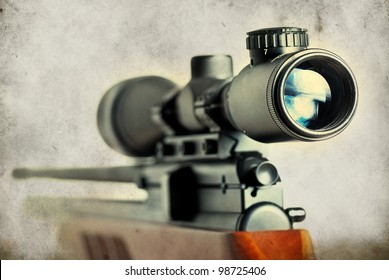Closeup of a sniper rifle telescope glass lens on grunge background