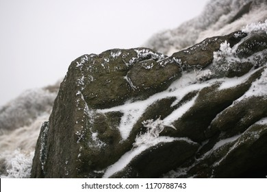 Close-up of snow and ice on a rock.