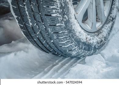 closeup snow tire in winter conditions