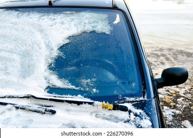 Close-up of snow-covered car windscreen