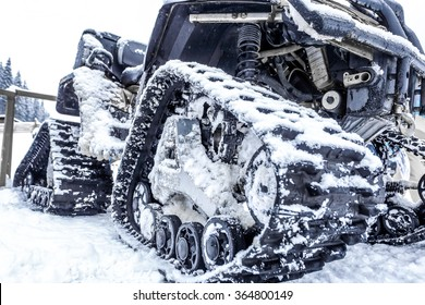 Closeup of a snowmobile with snow