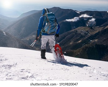 Close-up of snowshoeing activity in the italian alps