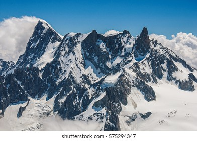 Close-up of snowy peaks and mountains, viewed from the Aiguille du Midi, near Chamonix. A famous ski resort located in Haute-Savoie Province, at the foot of Mont Blanc in the French Alps.