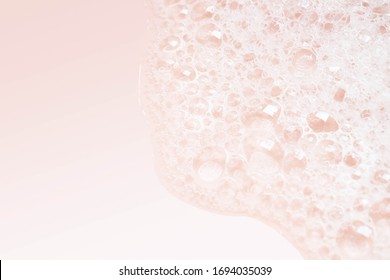 closeup Soap bubble foam on pink background
