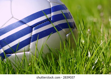 Close-up of soccer ball in grass