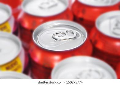 closeup of a lot of soda cans
