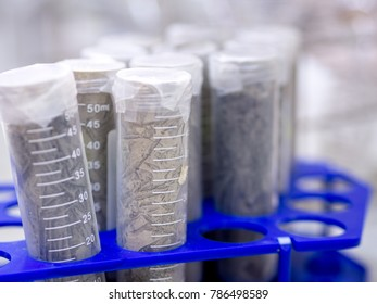 Closeup soil sampling tube in laboratory.