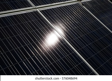 Closeup solar cell panel surface texture reflected sun's rays