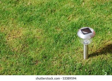 close-up of a solar garden light on green grass