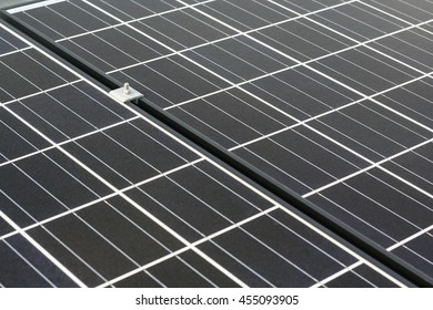 Closeup of solar panel and clamp