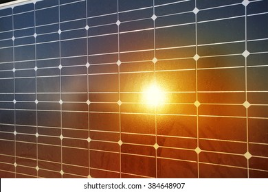 Close-up of solar panels with reflection of sunlight.