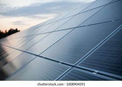 Close-up of solar panels at sunset