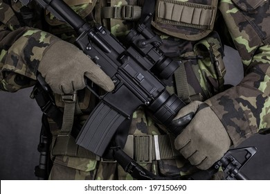 Close-up of a soldier holding modern weapon M4 carbine