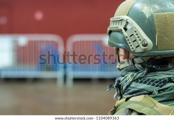 Close-up of soldier in military helmet on guard