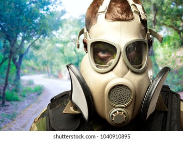 Close-up Of Soldier Wearing Mask against a nature background