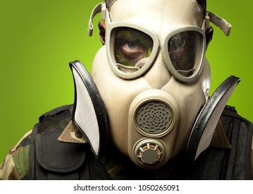 Close-up Of Soldier Wearing Mask against a green background