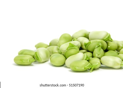 closeup of some broad beans isolated on a white background