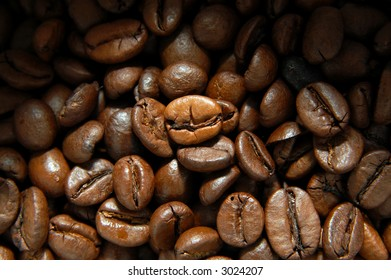 Closeup of some coffee beans with light effect