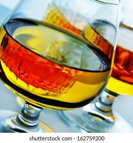 closeup of some cognac glasses with liquor