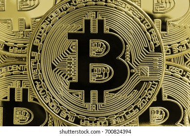 Close-up of some golden Bitcoins seen from above to visualize cryptocurrency.