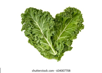closeup of some leaves of kale forming a heart on a white background
