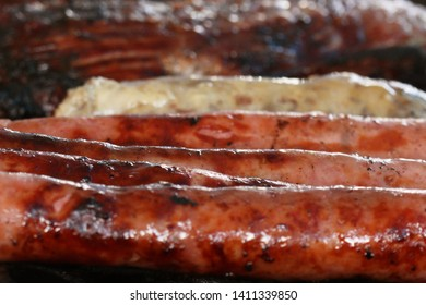 closeup of some meat being grilled in a barbecue