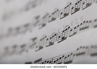 closeup of some musical notes in a blurred music score