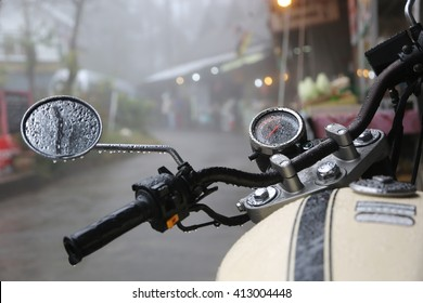 Closeup in some part of vintage motorcycle riding in the rain