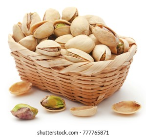 Closeup of some roasted pistachio in basket over white background