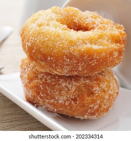 closeup of some rosquillas, typical spanish donuts, on a set table