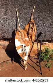 Close-up South African Zulu spears, warrior leather shields and assegai. Traditional tribal ethnic weapon.