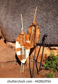 Close-up South African Zulu spears, warrior shields and assegai. Traditional tribal ethnic weapon.