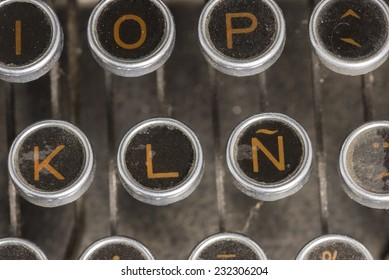 Closeup to the spanish keyboard of an antique mechanical desktop typewriter with the spanish letter ñ