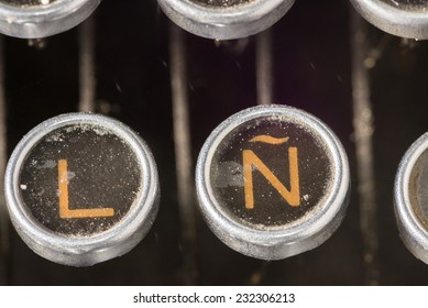Closeup to the spanish keyboard of an antique mechanical desktop typewriter with the spanish letter Ã?Â?