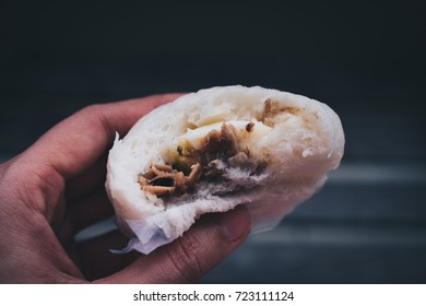 Close-up of the special chicken siopao, a Filipino version of the Chinese or Cantonese steamed bun.  Personal perspective. Toned picture.
