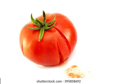 Closeup of splattered tomato on white background