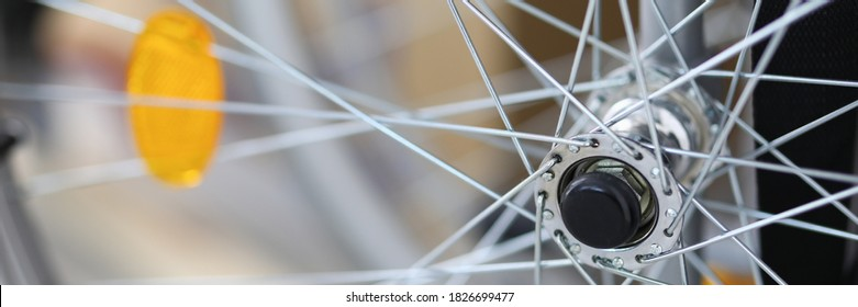 Close-up of spokes on clean shiny bicycle standing outside on street. Part of bike. Detail or component of transportation. Vehicle and transport concept