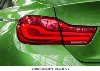 Close-up sports car rear tail-lamp with a brakelight stop signal