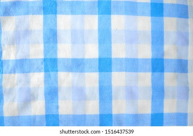 Closeup of squared texture pattern. Blue and white checkered tablecloth. Background of blue plaid material.