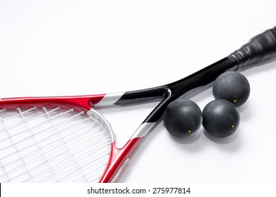Closeup of Squash racket isolated on white with balls