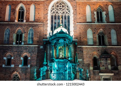 Closeup of St. Mary's Basilica (Church of Our Lady Assumed into Heaven) in Krakow, Poland at night